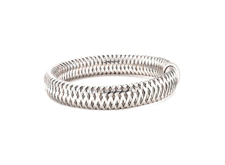 Designer: Roberto Coin  Material: 18k white gold Diamonds: 26 round brilliant cuts = .25cttw Color: G Clarity: VS1 Dimensions: bracelet will fit up to a 7-inch wrist Weight: 27.76 grams