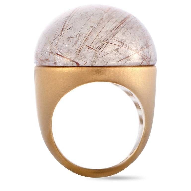 This Roberto Coin ring is crafted from 18K rose gold and set with a rutilated quartz. The ring weighs 32.2 grams, boasting band thickness of 5 mm and top height of 14 mm, while top dimensions measure 32 by 25 mm.  Ring Size: 6.25  Offered in brand