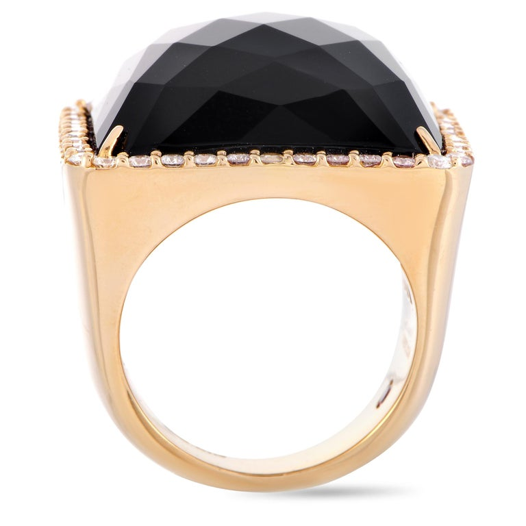 """The Roberto Coin """"Cocktail"""" ring is crafted from 18K rose gold and weighs 23.6 grams, boasting band thickness of 6 mm and top height of 7 mm, while top dimensions measure 24 by 24 mm. The ring is set with an onyx and a total of 0.93 carats of"""