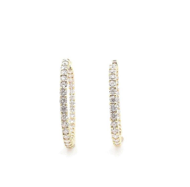 Authentic Roberto Coin 18 karat yellow gold hoop earrings set with approx. 2.5 carats of round brilliant cut diamonds (F color, VS clarity). Marked 1226VT 18K. Robert Coin signature ruby stone. Earrings measure 25mm x 32mm. Does not come with