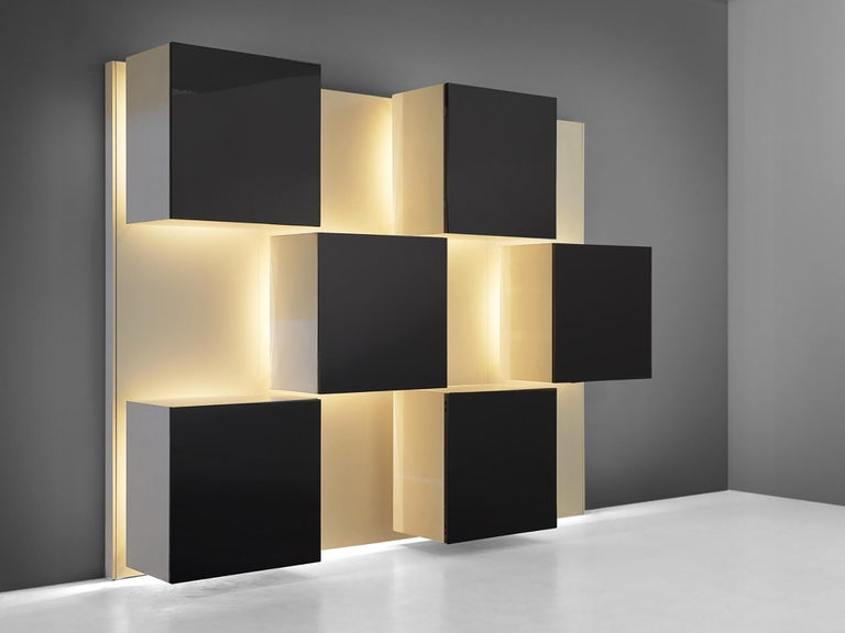 Wall unit, in wood and glass, by Roberto Monsani for Acerbis, Italy, 1970s.   Stunning wall unit by Italian designer Roberto Monsani for Acerbis. This wall sculpture is beside a great esthetic piece also highly functional. Each 'black box' is a