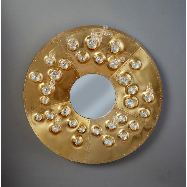 "Roberto Rida (b. 1943) and Simone Crestani (b. 1984)  An exceptional mirror by Roberto Rida and Simone Crestani, in gilt bronze and blown glass.   Unique piece.   Dimensions: 23.5"" Ø, 6.5"" D."