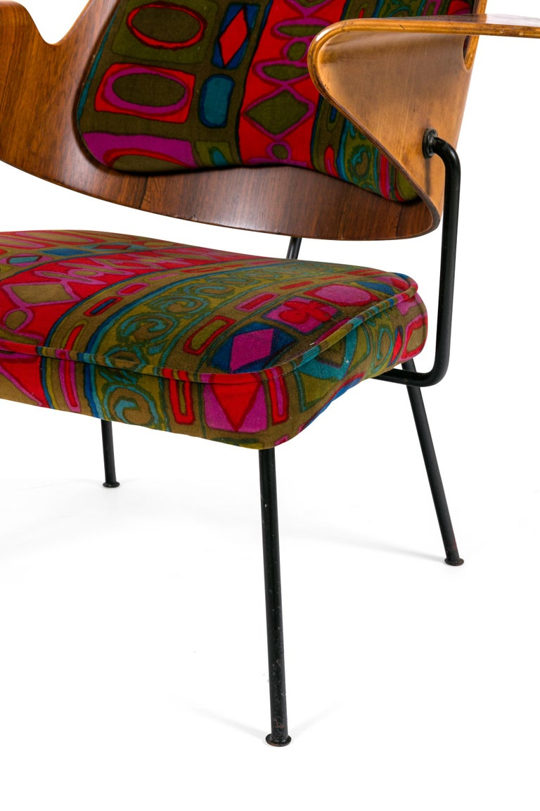 This epitomizes the revolutionary new aesthetic of the post-war style. Its period upholstery, organic sculptural seat back and minimalist frame makes it unlike any chair produced in Britain before.