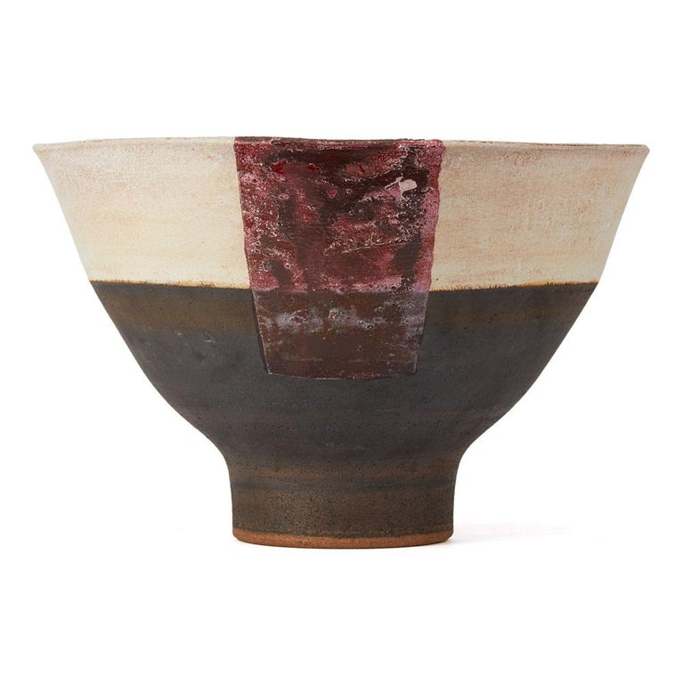 PLEASE NOTE: This piece is currently located in our Amsterdam office, please enquire for delivery times.  A large, vintage British studio pottery stoneware footed bowl by Robin Welch. The rounded bowl stands on a narrow rounded foot and is decorated