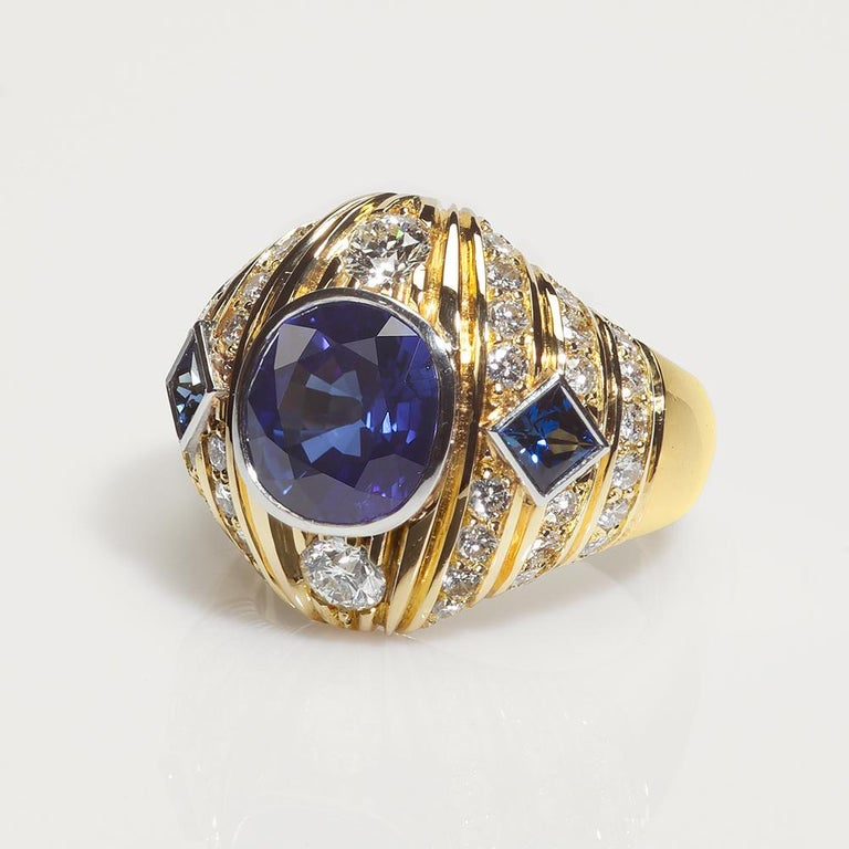 This elegant One-of-a-kind ring from Etruscan Revival signature collection reminiscent of ancient Mediterranean aesthetic blending vibrancy and structural symmetry. The center of attention, Rich Royal Blue Cushion cut Ceylon Sapphire within a harem