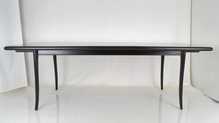 Great form on this dining table. Fully restored with new black/brown satin finish. Single leaf allows the table to extend to 92
