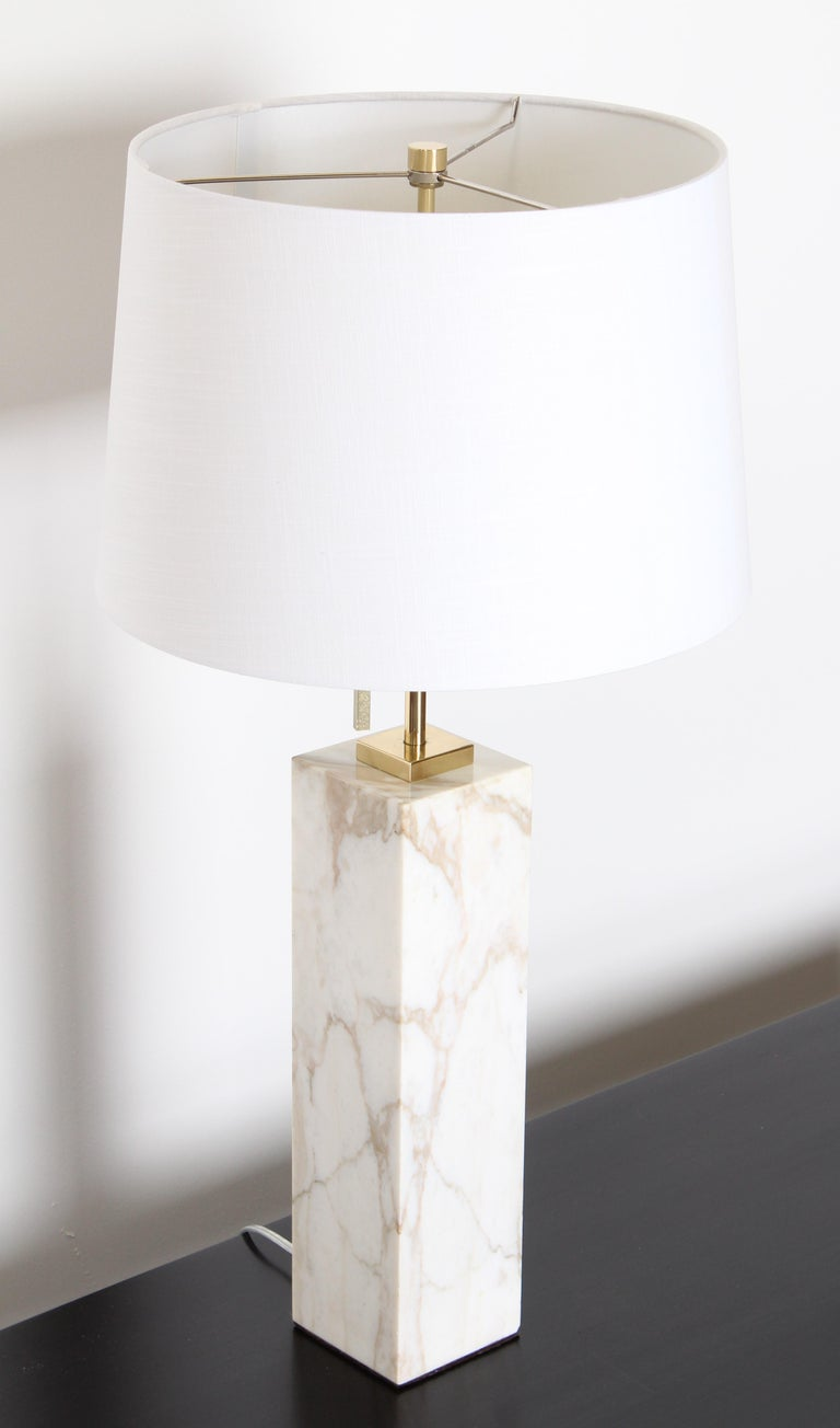 A Robsjohn-Gibbings marble lamp with white and cream tones by Hansen Lighting, 1950s. Recently rewired and new polished hardware. Shade not included.