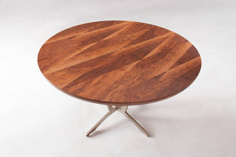 The Robson Table has a classic circular shape and elegant woodwork. Available in a variety of American hardwoods with surface patterns ranging from simple flat sawn to geometric (shown). Each piece is made to order, so dimensions, hardwood, pattern