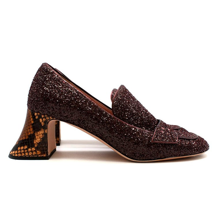 Rochas Purple Glitter Python Effect Block Heeled Pumps  - Python effect block heel  - Purple glitter covered outer  - Almond toe  - Front loafer penny strap - Pink leather lining  - Original dust bag included   Materials:  Upper - fabric  Lining -