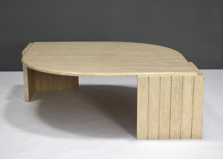 Teardrop shaped travertine coffee table by Roche Bobois, France, circa 1970.  Designer: Unknown  Manufacturer: Roche Bobois  Country: France  Model: Coffee table  Material: Travertine  Design period: circa 1970  Date of manufacturing: