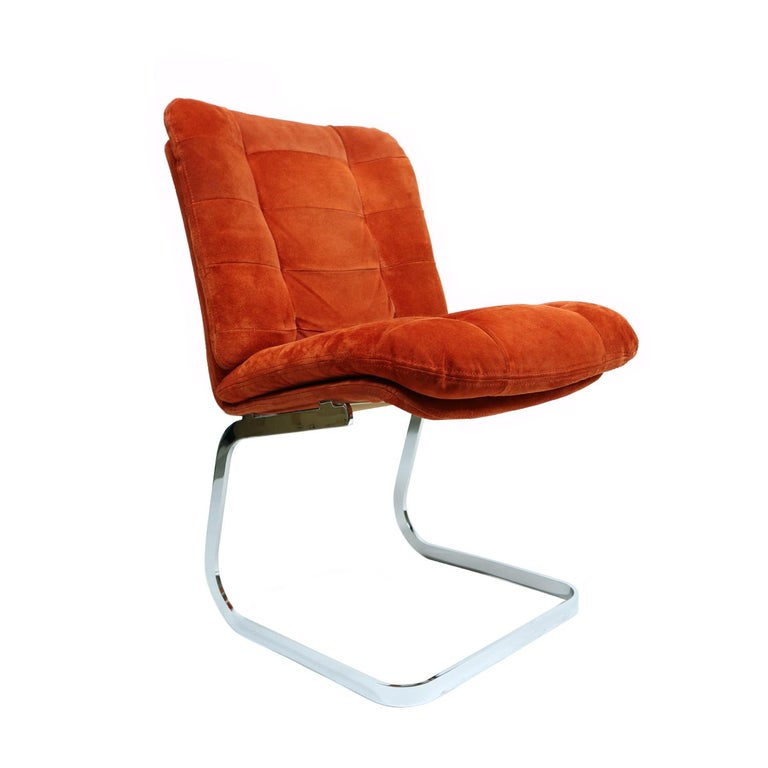Original set of (6) exquisite Roche Bobois dining / side chairs. These channel tufted burnt orange suede chairs are equal parts 70's glamorous and modern. The original chrome finish has been hand polished allowing the metals to gleam in the light.