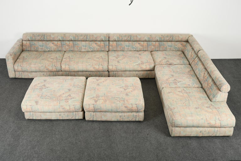 A fabulous monumental Roche Bobois sectional sofa with original fabric and pillows. This beautiful sofa can be used with its original upholstery temporarily however we are selling it as new upholstery recommended. It is a great form to reupholster
