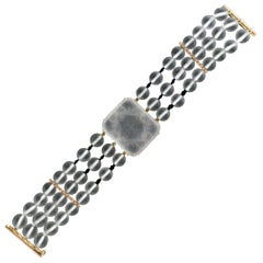 Rock Crystal 14 karat Yellow Gold Onyx Diamonds Cuff Bracelet