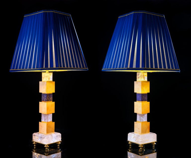 Rock crystal and lapis lazuli pair of lamps. Limited edition of three pairs. The lamp has a system of adjustable lamp shade, so you can adjust the height of the lamp shade. Dimensions: Base: 4.5 X 4.5 inches 16.5 inches under the lamp