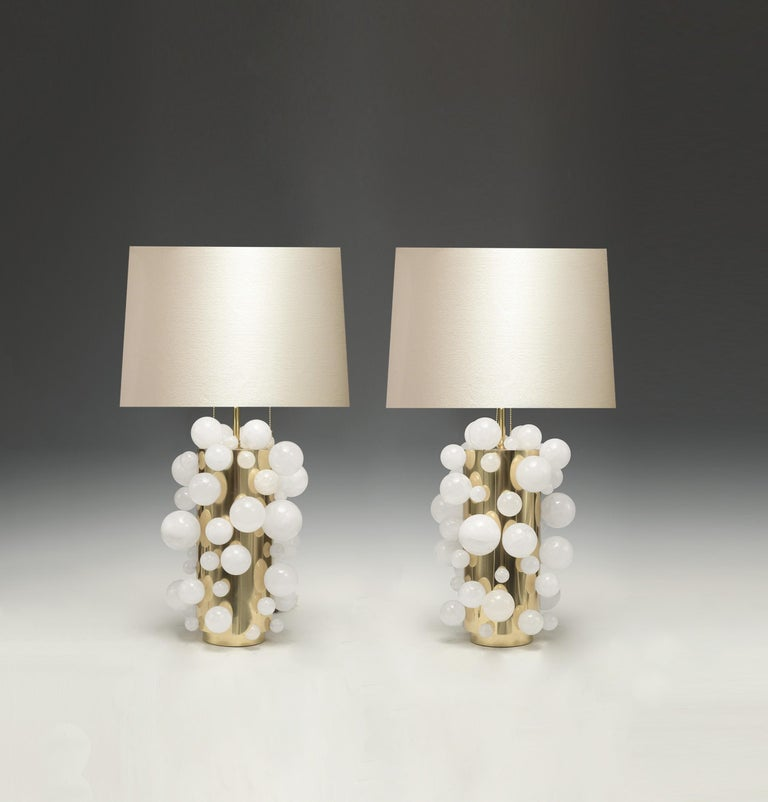 A pair of luxury white rock crystal quartz bulb lamps with polished brass bases, created by Phoenix Gallery, NYC.