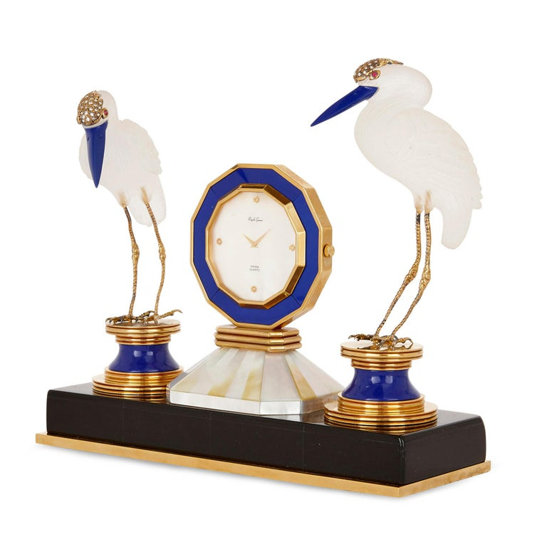 Crafted from the very best of materials, including black onyx, lapis lazuli, rock crystal, diamonds, and rubies, this table clock by the Swiss maker Royale Geneve is materially splendid—it is also charming in its form, including as it does twin