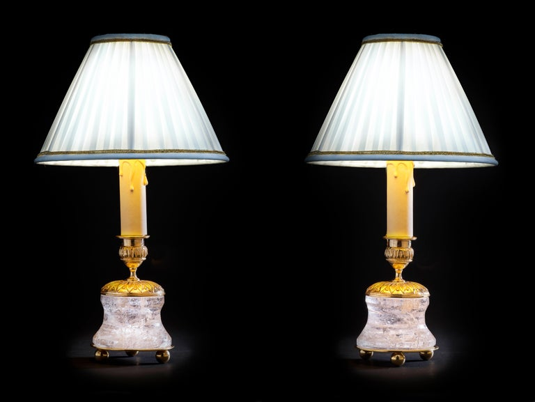 Rock crystal French First Empire style 24-karat ormolu gilding bronze Ivory lampshades made by Alexandre Vossion. This model can be also used as candlesticks to make your dining table so chic... Others colors for the lampshades are also available