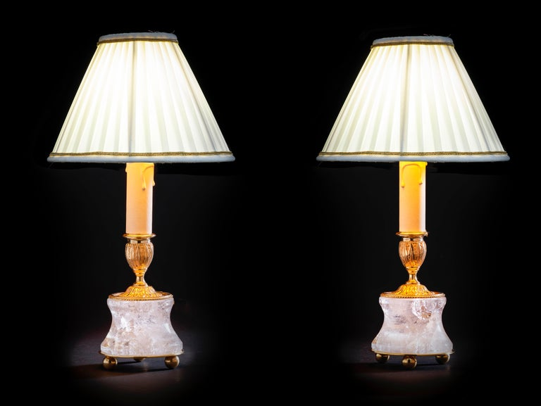 Rock crystal lamps by Alexandre Vossion. Model III, Louis XVI style. Rock crystal polished and carved stone, bronze, 24-karat gilding, customized lampshade. Two in ones: you can easily used as a pair of candlesticks on your dining table but also