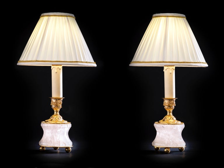 Rock crystal lamps by Alexandre Vossion. Model I, Louis XVI style. Rock crystal polished and carved stone, bronze, 24-karat gilding, customized lampshade. Two in ones: you can easily used as a pair of candlesticks on your dining table but also as