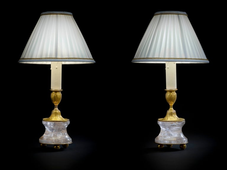 Rock crystal lamps by Alexandre Vossion. Model II, Louis XVIth style. Rock crystal polished and carved stone, bronze, 24-karat gilding, customized lampshade. Two in ones: You can easily used as a pair of candlesticks on your dining table but also