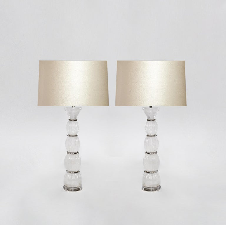 Pair of rock crystal lamps with nickel plating insert decoration. Created by Pheonix Gallery, NYC. To the top of the rock crystal is 17 in. (Lampshade not included). Custom size and metal finish upon request.