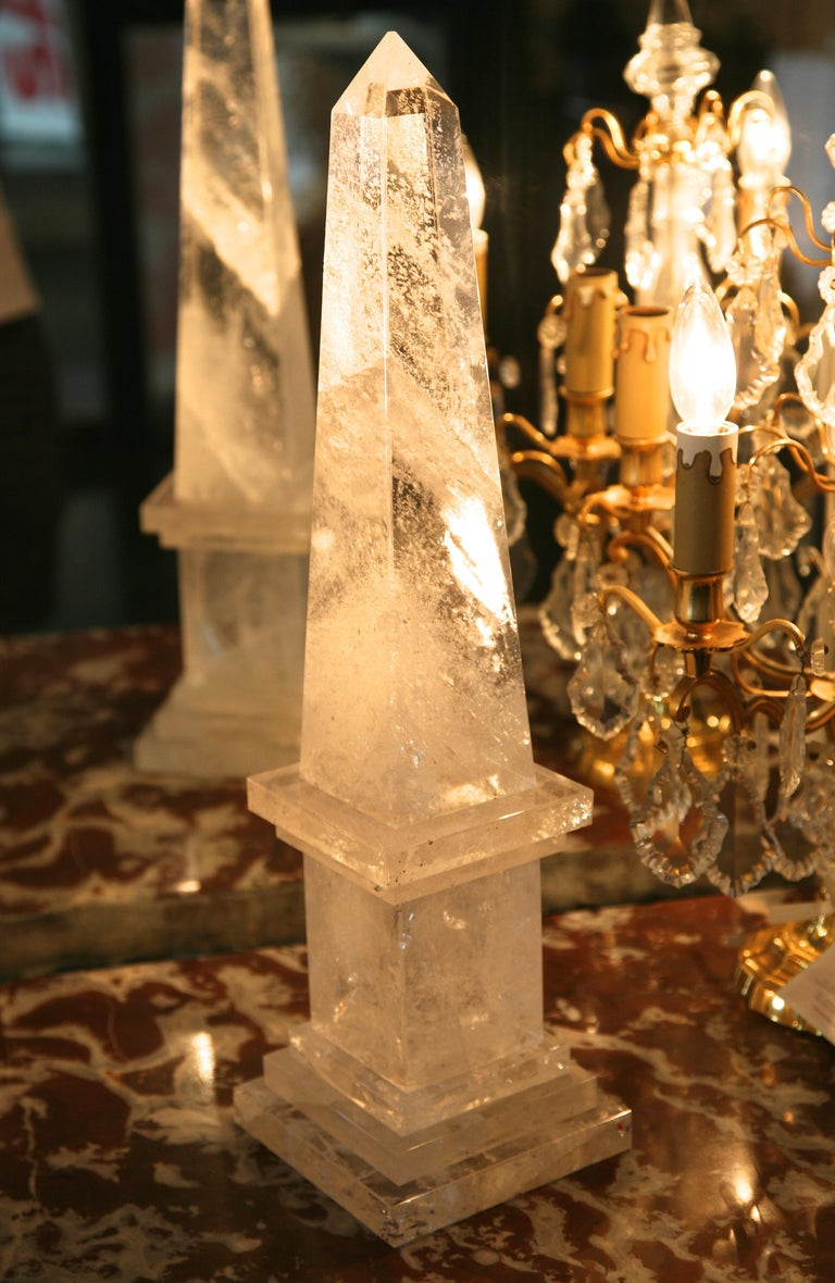 Fine large pair of neoclassical rock crystal obelisks with square base. Very harmonious proportions, exquisite clarity, French, early 20th century. An architectural pair of decorative, Mid-Century Modern, Neoclassical Rock Crystal obelisks upon