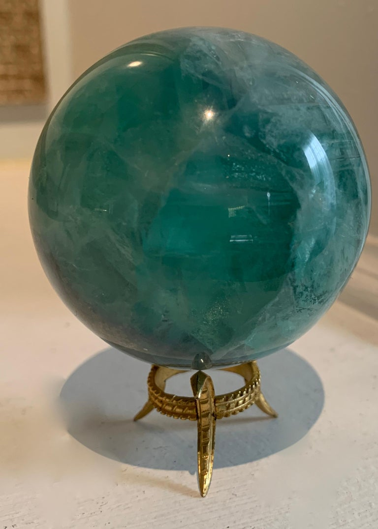 Rock crystal sphere on gold three pronged stand... a very elegant gift.
