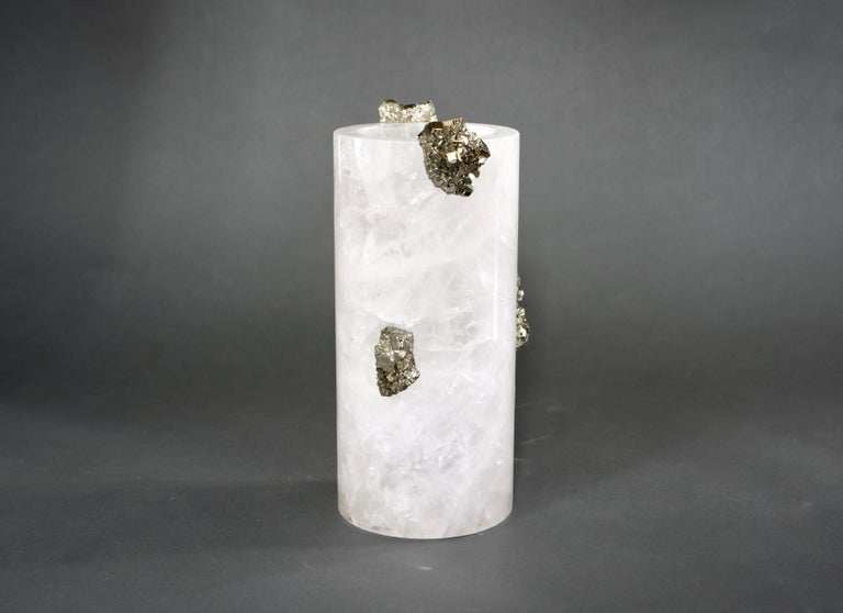 Rock crystal vase with gem stone decoration.