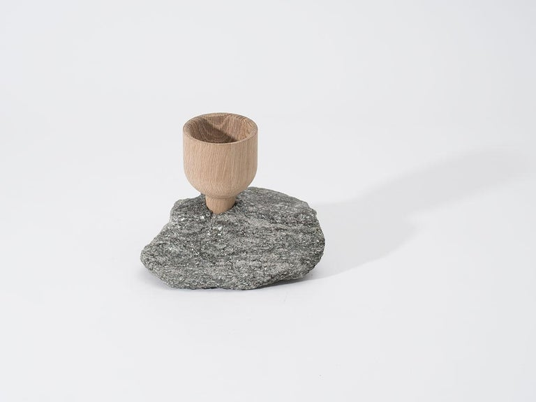 A sculpture made of rock and wood. A mix of natural materials in a refined and raw state. Hand-turned white oak