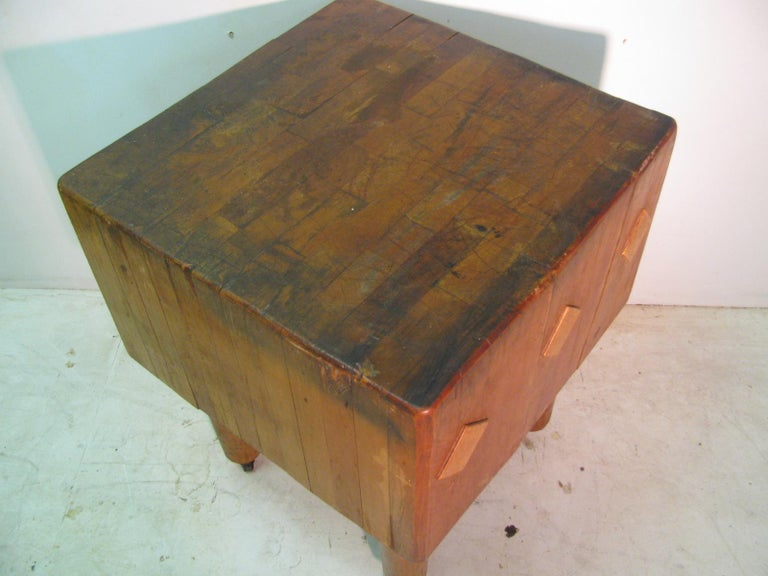 Huge and worn in all the right places. Butcher block table from a upstate restaurant, circa 1930. On wheels which helps to mobilize.