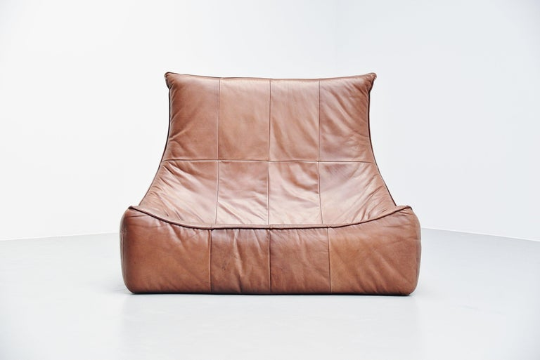 Stunning well known sofa from the so called Rock series, also called the Florence. Designed by Gerard van den Berg and manufactured by Montis, Holland, 1970. This example comes in very nice medium brown buffalo leather and has a splendid patina from