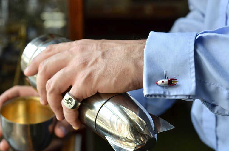 DEAKIN & FRANCIS, Piccadilly Arcade, London  Prepare for blast off! 10, 9, 8, 7, 6, 5, 4, 3, 2, 1, 0....These pocket rockets are great accessories for space fanatics!  With a shiny metal exterior and red detailing these rocket cufflinks are