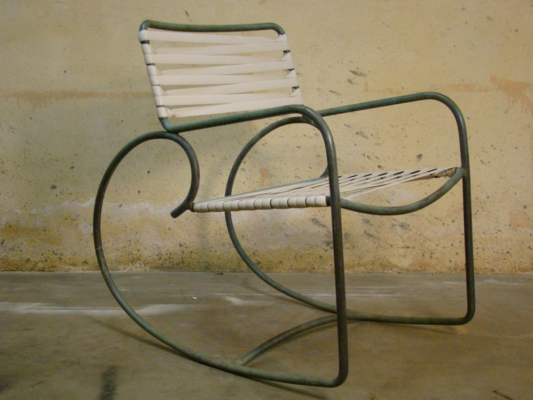 Early and rare Walter Lamb rocking chair, webbing is not original but chair is in amazing condition with a beautiful turquoise patina to the bronze tubing.  Truly iconic and handcrafted at Brown Jordan in the 1950s, solid examples are increasingly