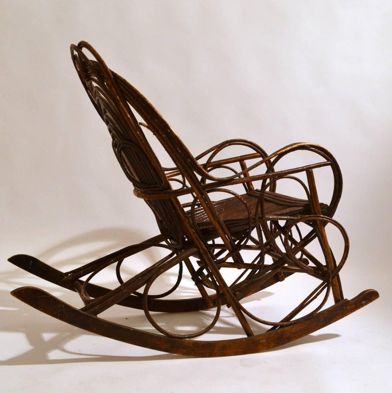Scandinavian early 20th century handmade rocking chair constructed in bentwood willow. Curvaceous lines create strength and make a beautiful pattern. The rocking slats are made of bent wood. The chair is extremely comfortable and has real