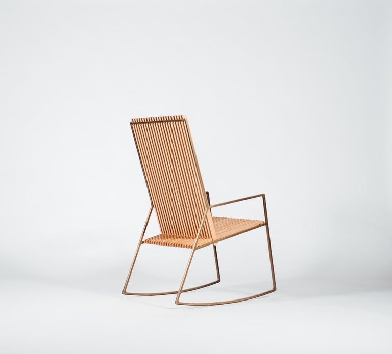 Iced tea in hand, Sam Cooke on the HiFi, the rocker tall is deeply rooted in Southern American porch culture. While its heritage might be southern, this contemporary Rocker by Klein Agency finds its minimal elegance in its lengthy back and slender