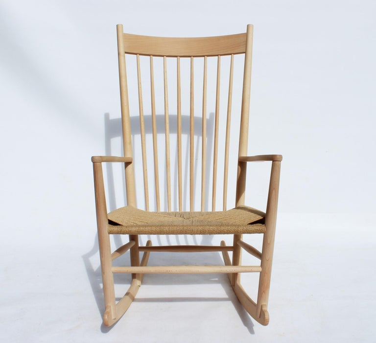 Rocking chair, model J16, of beech and paper cord, designed by Hans J. Wegner in 1944 and manufactured by Fredericia Furniture. The chair is in great vintage condition.