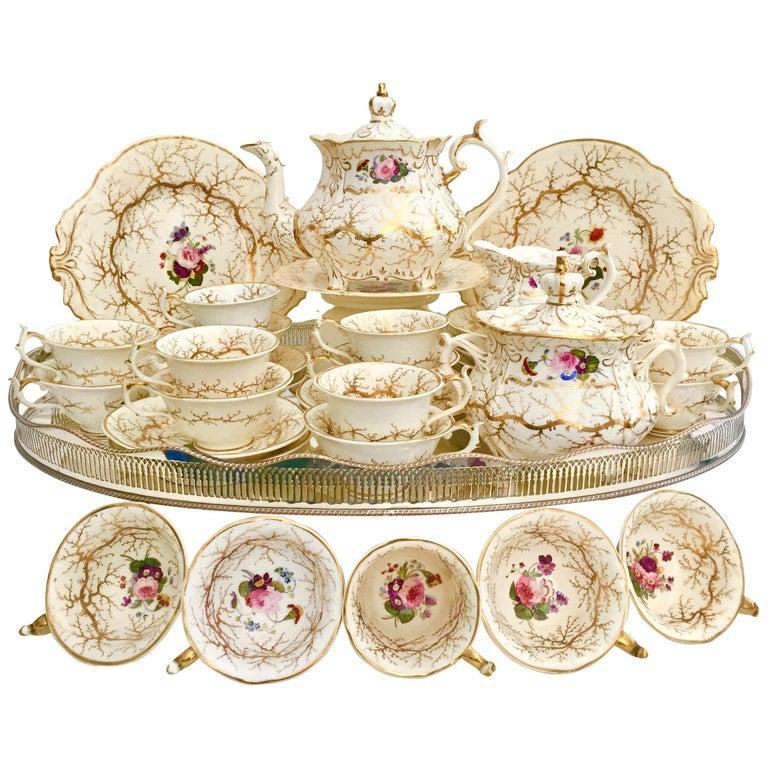 Rockingham Porcelain Tea Service, Cream, Gilt and Flowers, Rococo Revival, 1832 For Sale