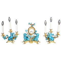 Rococo Chinosoiserie Style Three Piece Gilt Bronze and Porcelain Clock Garniture