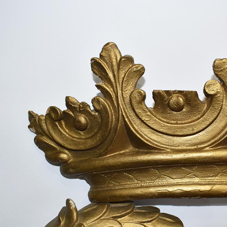 Elegant and ornate, this important giltwood double head Phoenix mirror is a wonderful example of Rococo style furniture and decor. Elaborately carved, the wood mirror frame features a double head phoenix bird with crown surmounted at the top. The