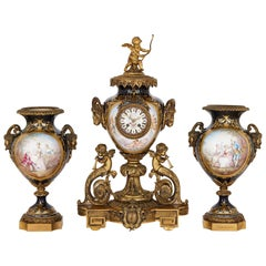 Rococo Style Gilt Bronze and Sèvres Style Porcelain Clock Garniture