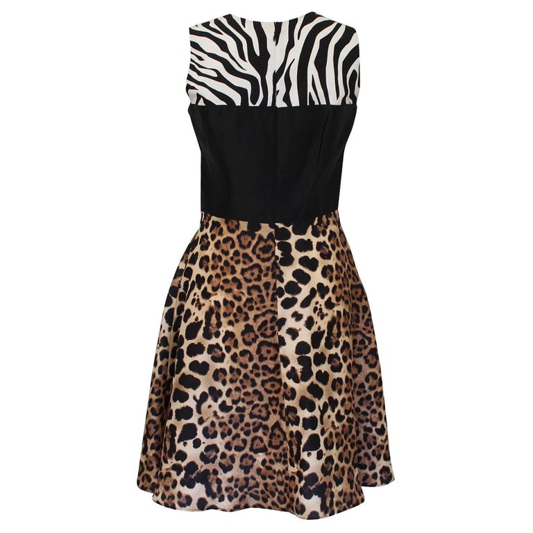 Beautiful printed dress by Rodarte 100% Silk Animalier print with black band Sleeveless Embroidered voile Total length cm 93 (36.6 inches) American size 4, italian size 40 Worldwide express shipping included in the price !
