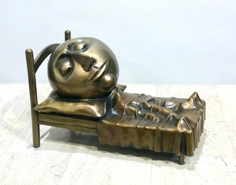 Slumber, Rodger Jacobsen bronze sculpture skinny man sleeping bed with big head - Gold Still-Life Sculpture by Rodger Jacobsen