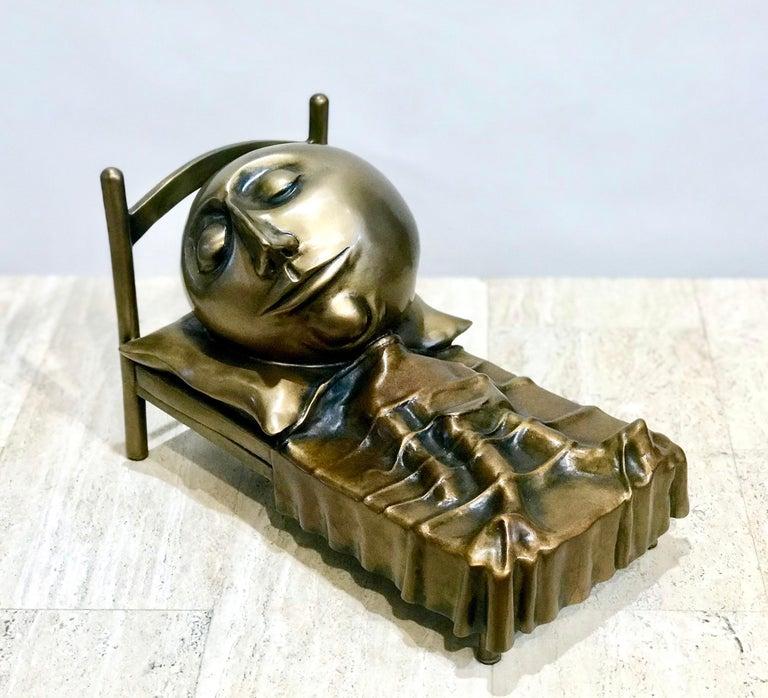 Slumber, Rodger Jacobsen bronze sculpture skinny man sleeping bed with a big head  Slumber, small bronze sculpture skinny man sleeping bed with a big head Jacobsen  bronze sculpture by Rodger Jacobsen
