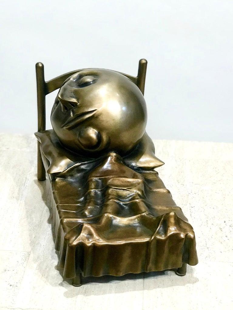 Slumber, Rodger Jacobsen bronze sculpture skinny man sleeping bed with big head For Sale 1