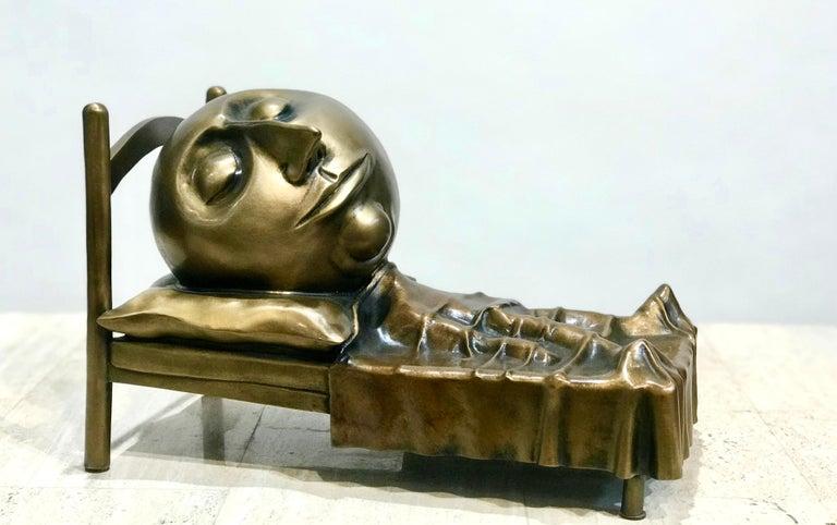 Slumber, Rodger Jacobsen bronze sculpture skinny man sleeping bed with big head - Sculpture by Rodger Jacobsen