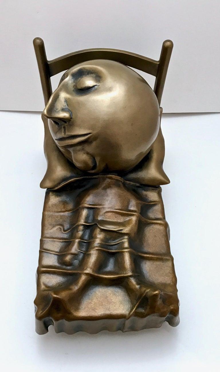 Slumber, Rodger Jacobsen bronze sculpture skinny man sleeping bed with big head For Sale 2