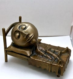 Slumber, small bronze sculpture skinny man sleeping in bed with a big head