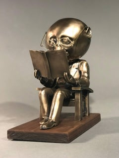 The Reader (small),gold bronze sculpture,reading book, glasses,Rodger Jacobsen