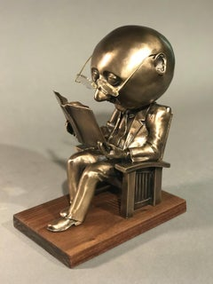 The Reader (small),Rodger Jacobsen gold bronze sculpture, reading book, glasses