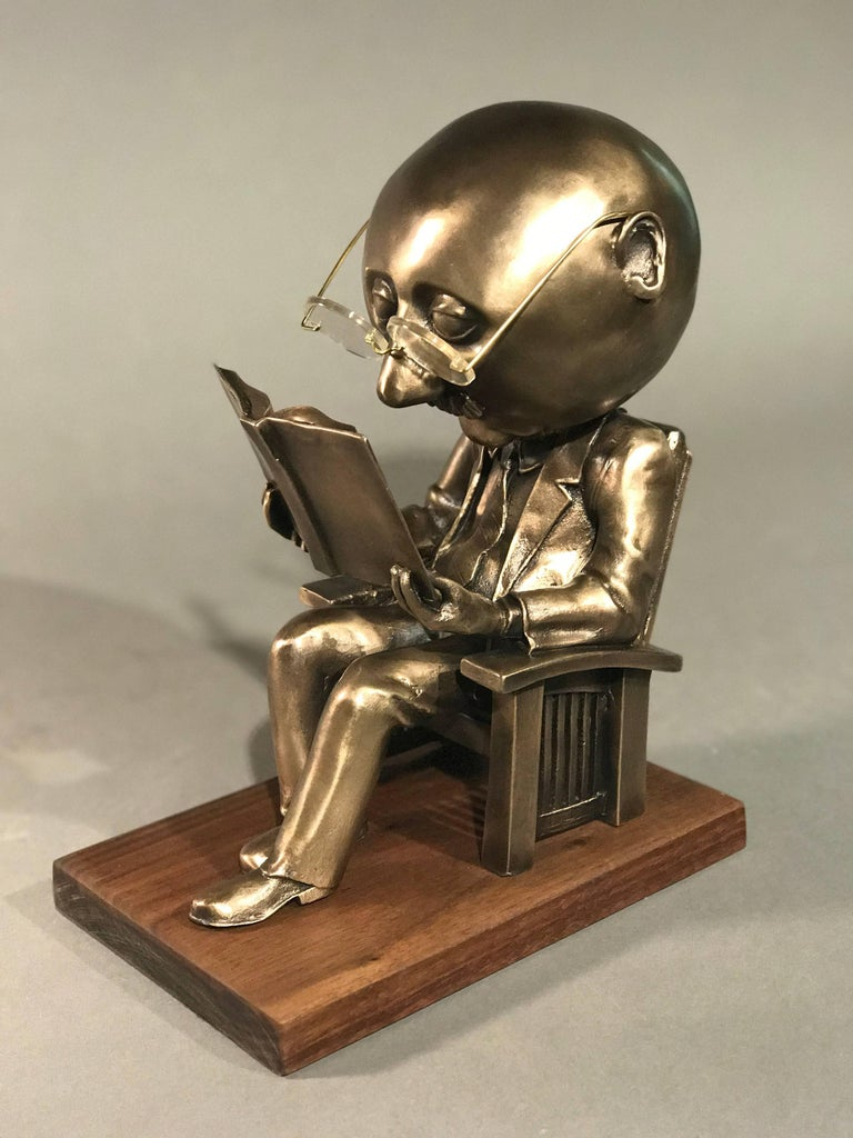 The Reader (small),Rodger Jacobsen gold bronze sculpture, reading book, glasses  - Art by Rodger Jacobsen